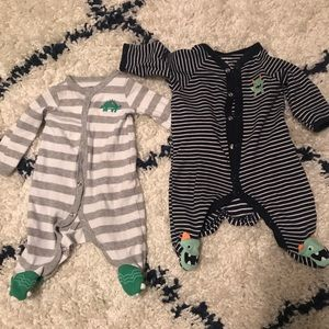 Carter's button up newborn sleepers.